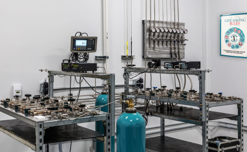 Image of lab equipped with compressed gas cylinders featuring cylinder regulators.