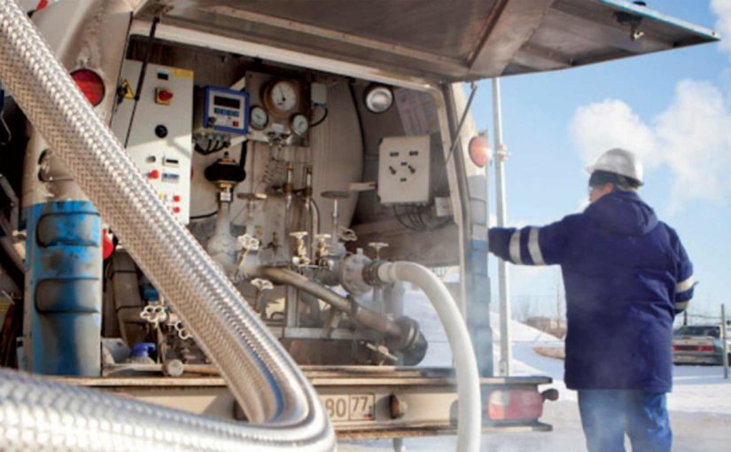 A worker in a hardhat stands by a truck with a built-in gas mixer.